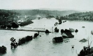 A river claimed the remaining railroad span in Asheville shortly after this photo was taken in 1916. (Photograph by Steve Nicklas, NOS, NGS; courtesy of National Oceanic and Atmospheric Administration/Department of Commerce)