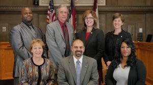 Asheville City Council 2018: Standing, left to right, are Keith Young, Brian Haynes, Mayor Esther Manheimer and Julie Mayfield. Seated, left to right, are Vice Mayor Gwen Wisler, and newly elected councilmembers Vijay Kapoor and Sheneika Smith.