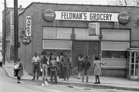 people milling around Feldman's grocery