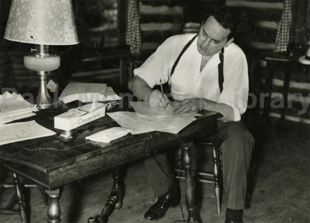 Famous Asheville author Thomas Wolfe, writing at his cabin.