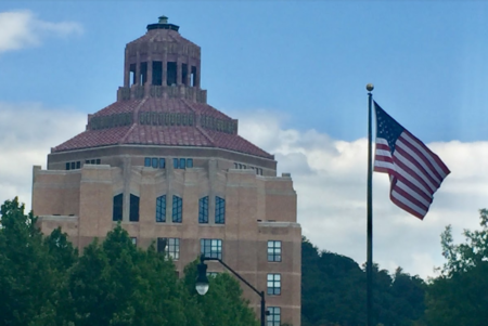 Asheville City Hall, flag flying in foreground